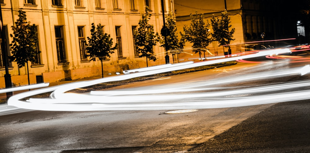 time lapse photography of road and vehicle during nightime