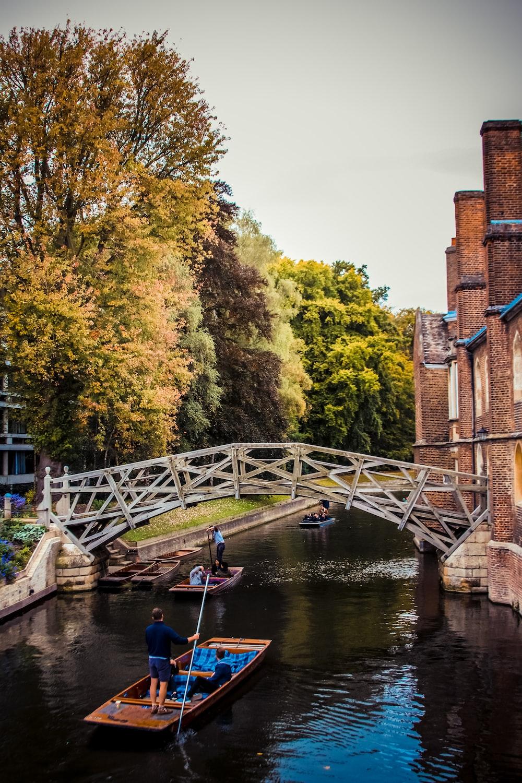 sailing boats under bridge