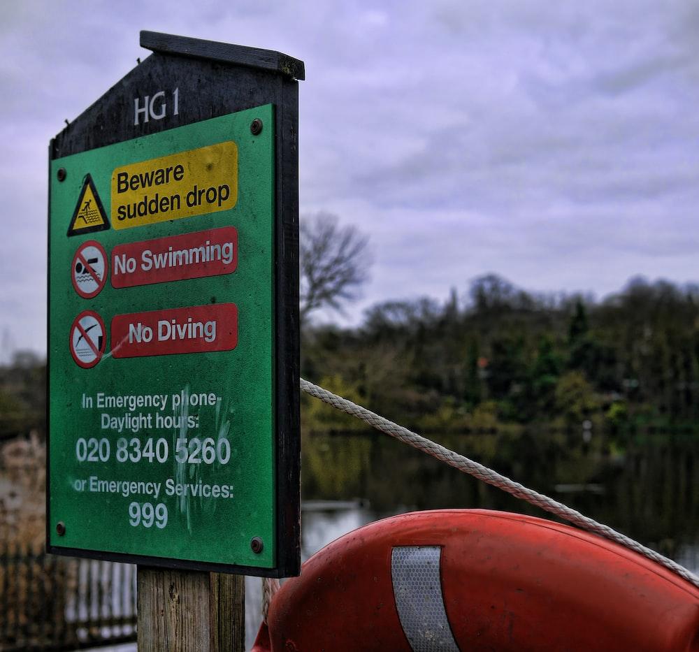 beware sudden drop, no swimming, no diving signs