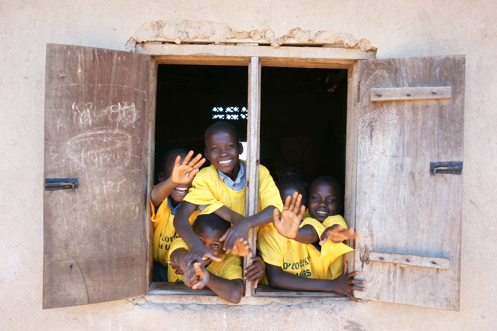 children at the window of a building