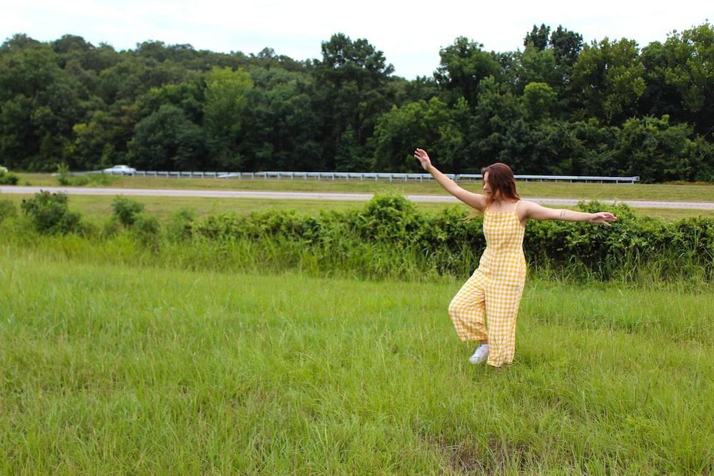 woman wearing yellow jumpsuit