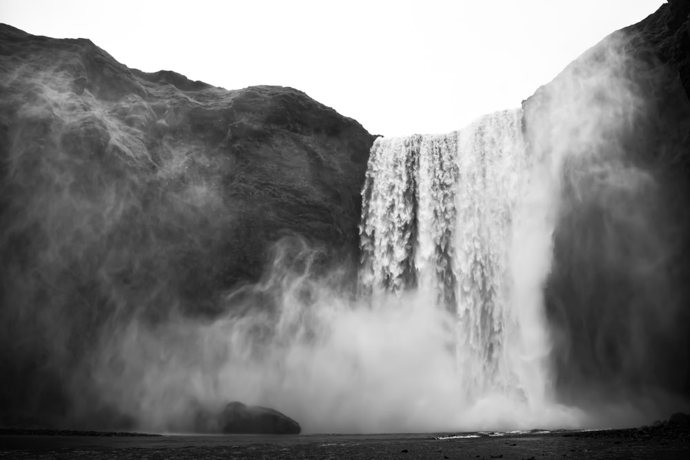 greyscale photo of waterfalls