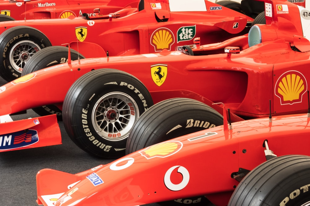 red and yellow Formula 1 race cars