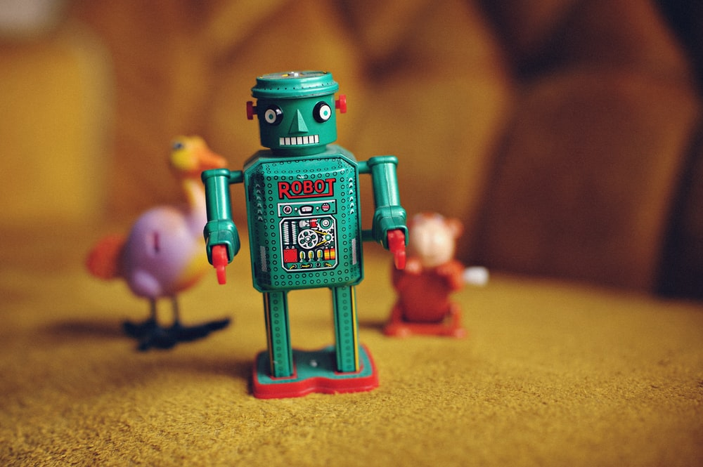 green and multicolored robot figurine