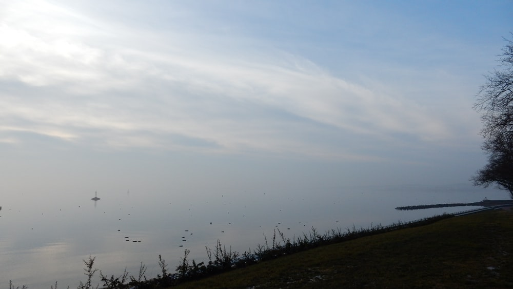 body of water and white clouds