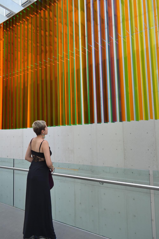 woman wearing black spaghetti strap dress
