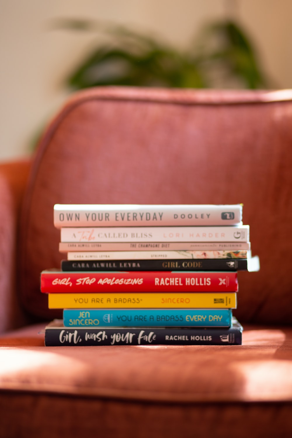 selective focus photography of pile of book