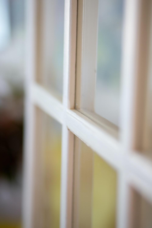white wooden framed glass window