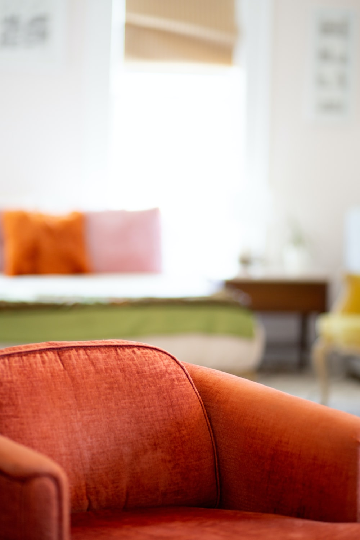orange padded sofa chair