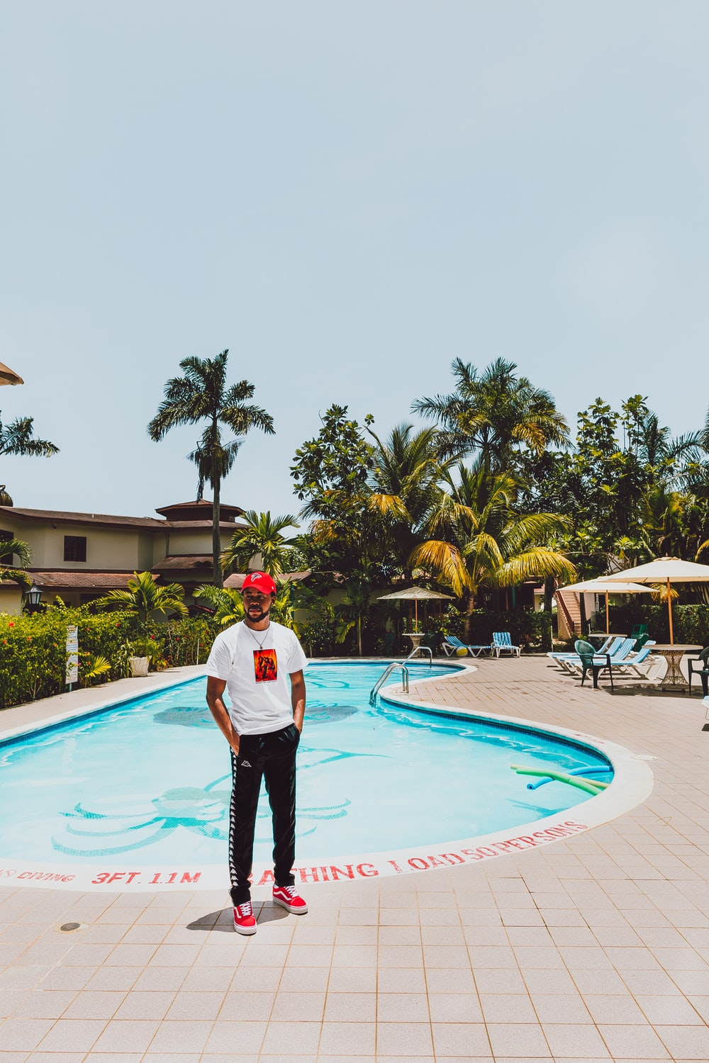 man standing near pool