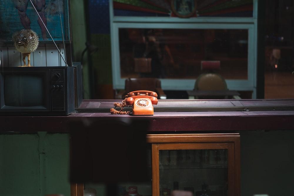 orange rotary telephone