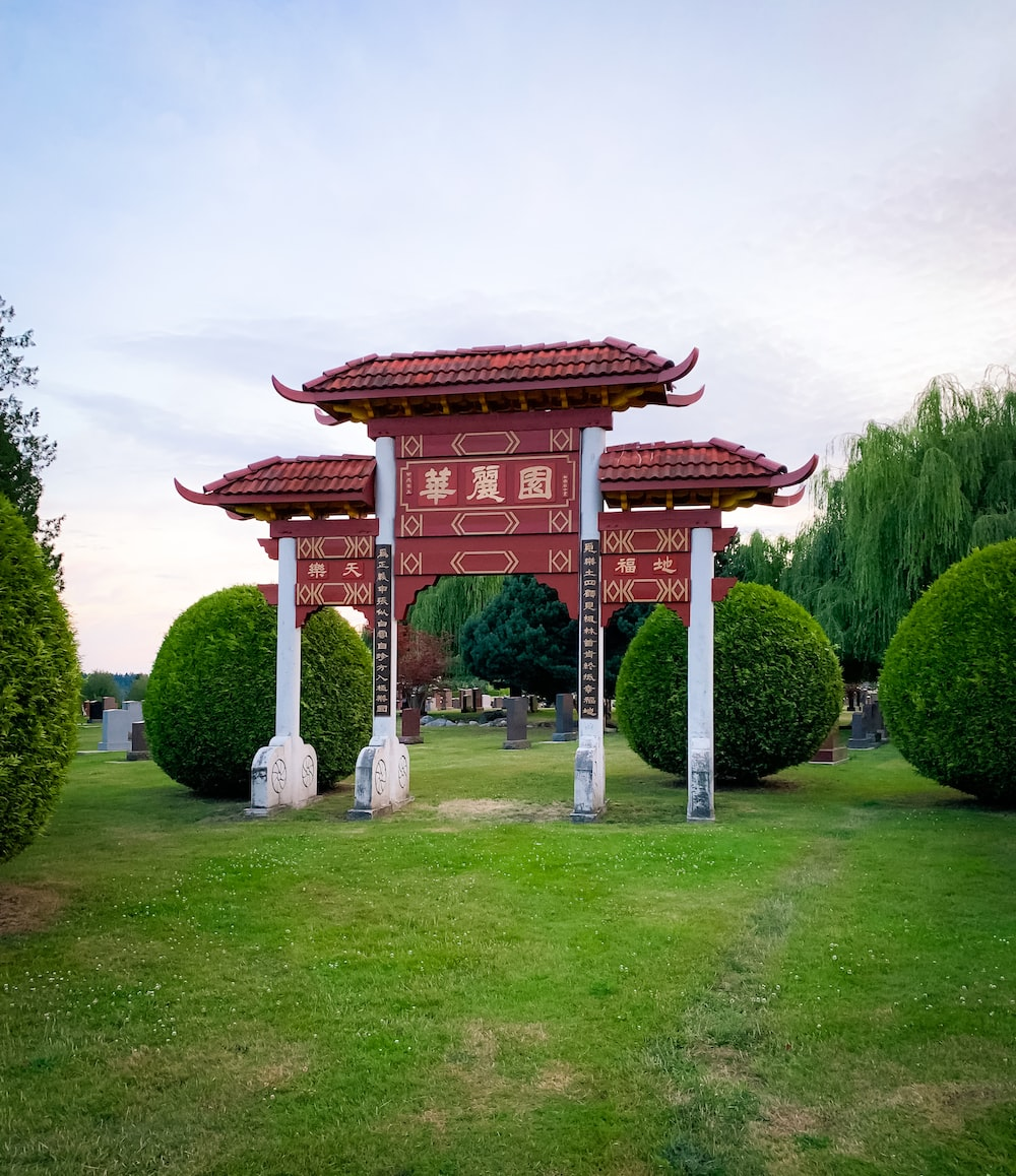 maroon and white arch and grass field scenery