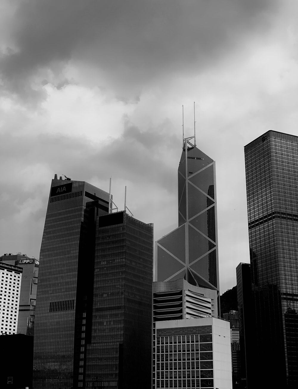 grey clouds over city buildings