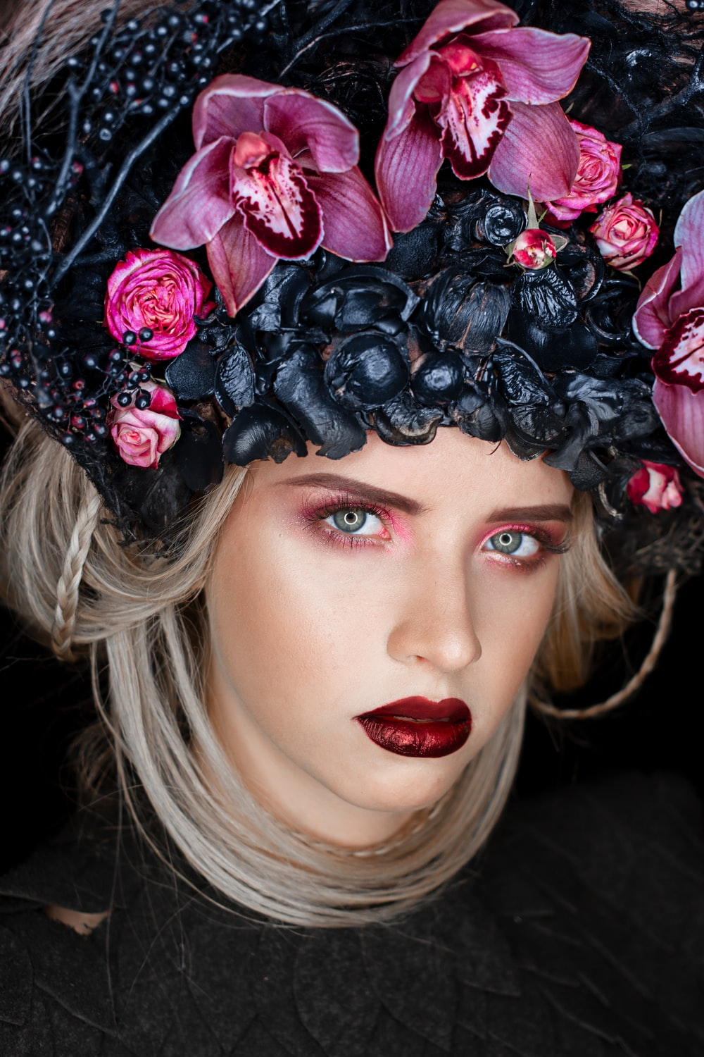 woman wearing black and purple flower headdress