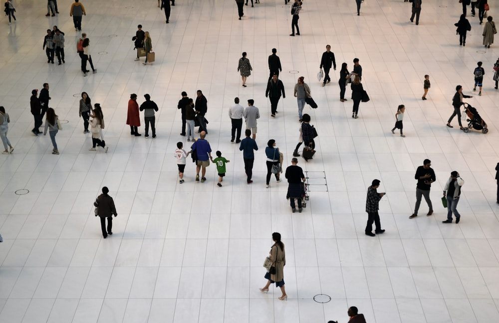 people standing on white floor tiles