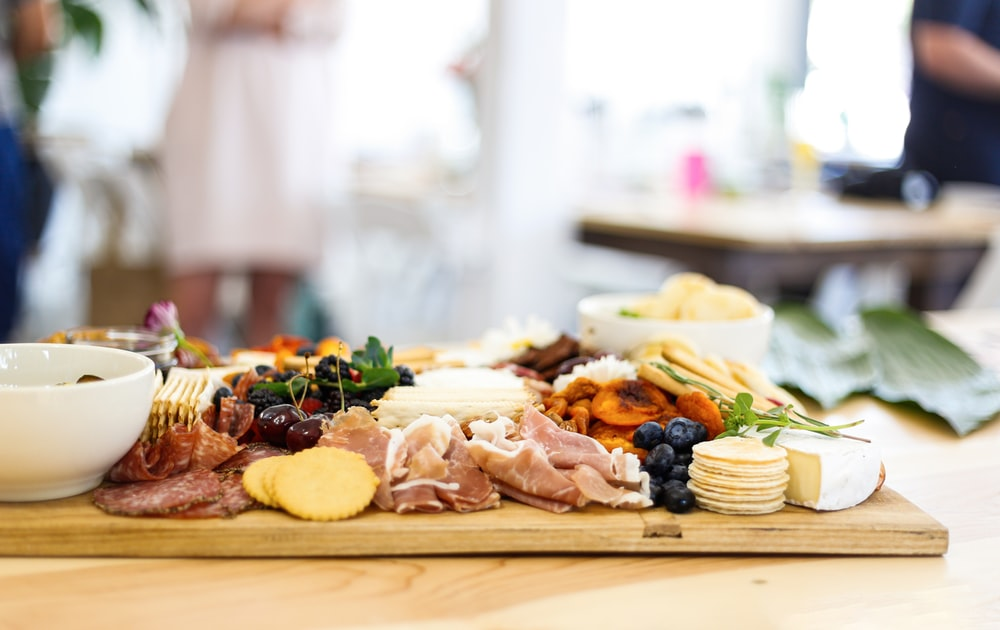 food and pastries on wooden chopping board