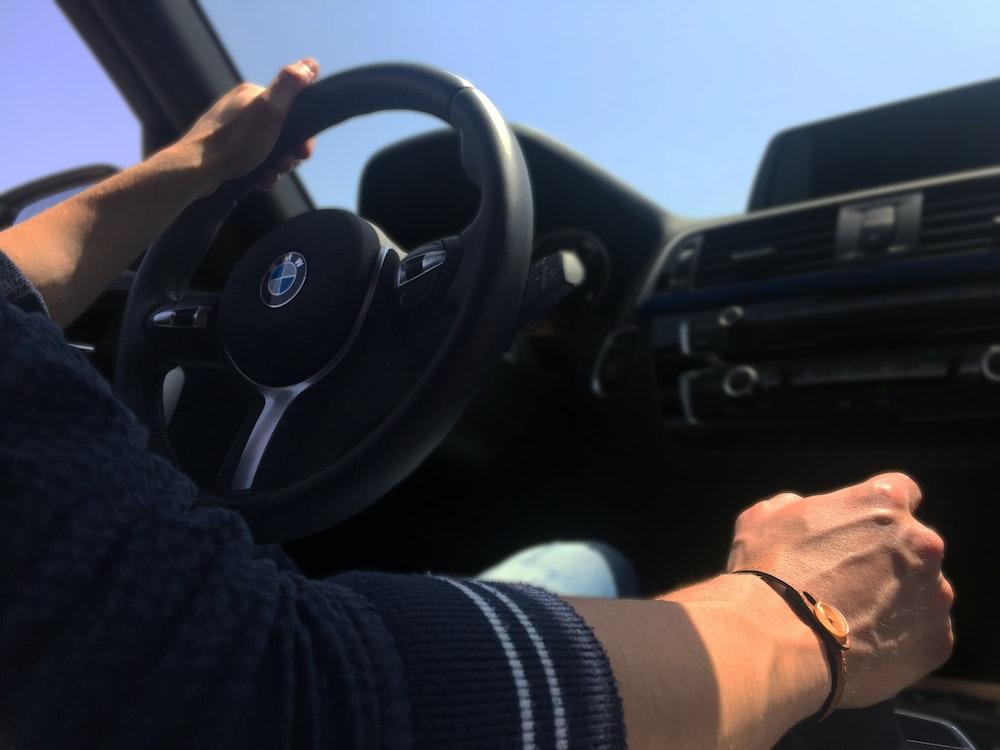 man inside BMW vehicle