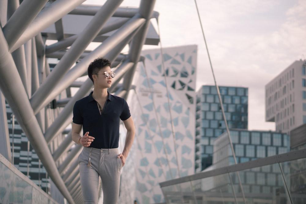 man wearing black shirt and grey pants