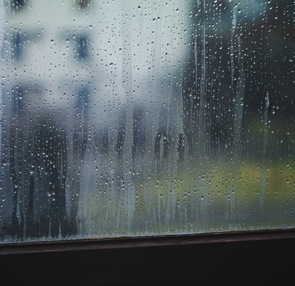 closeup photo of pane window with raindrops