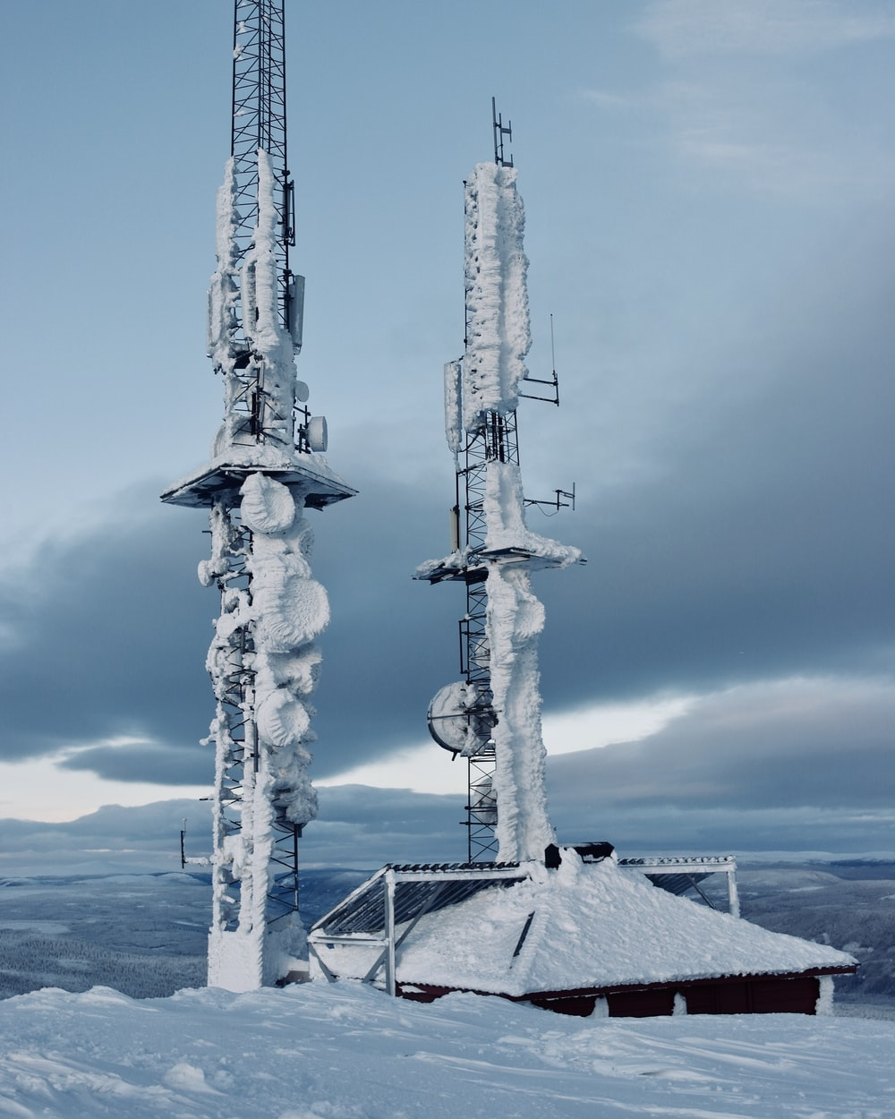 snow covered tower during daytime