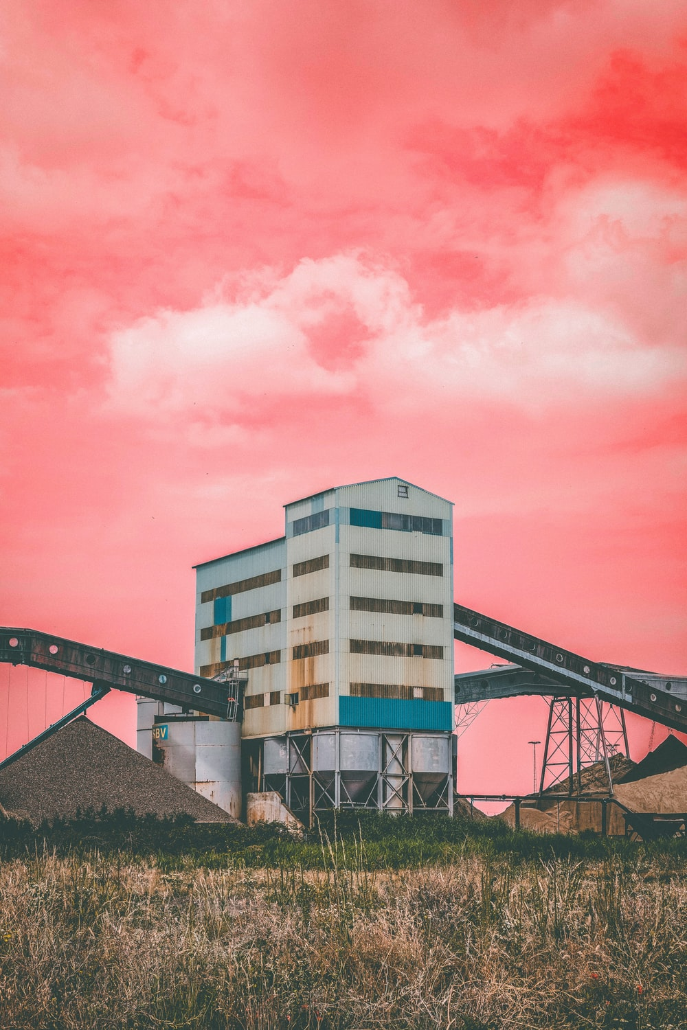 white concrete building under pink sky