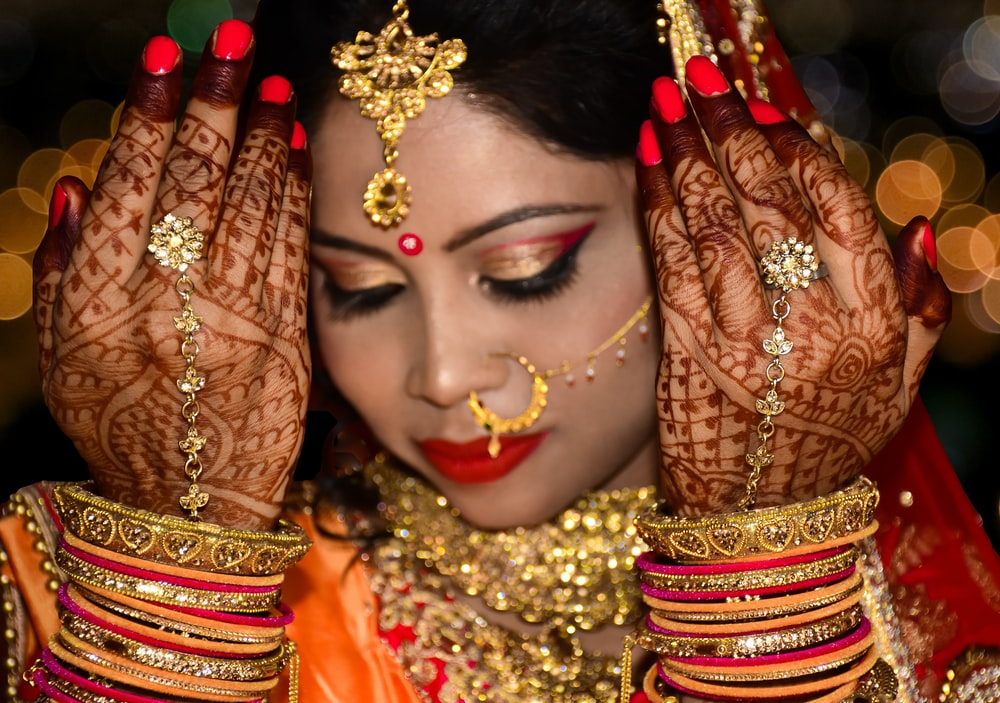 women's gold-colored bangles