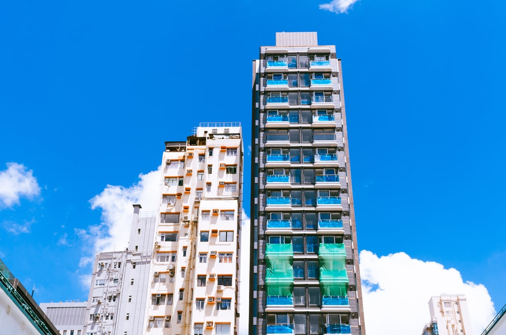 white and blue high-rise buildings