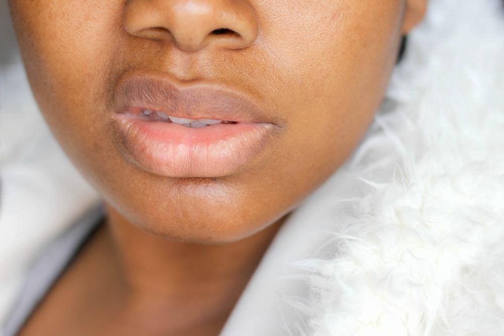 woman wearing white fur top