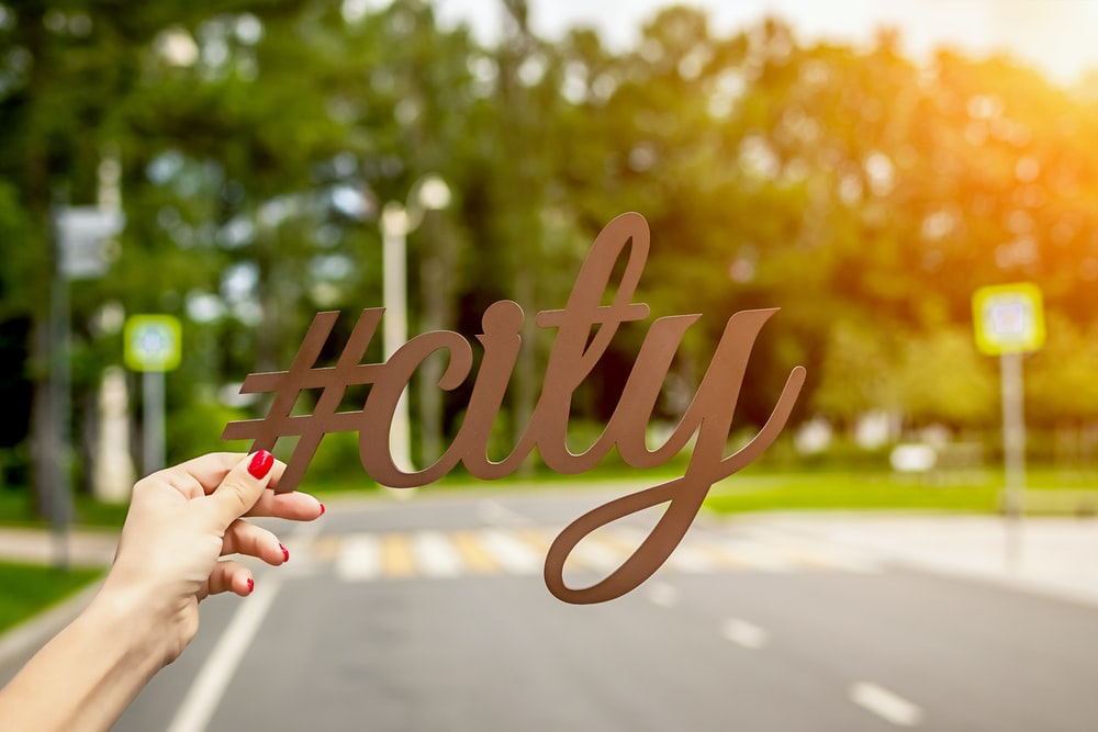 person holding #City cutout letter