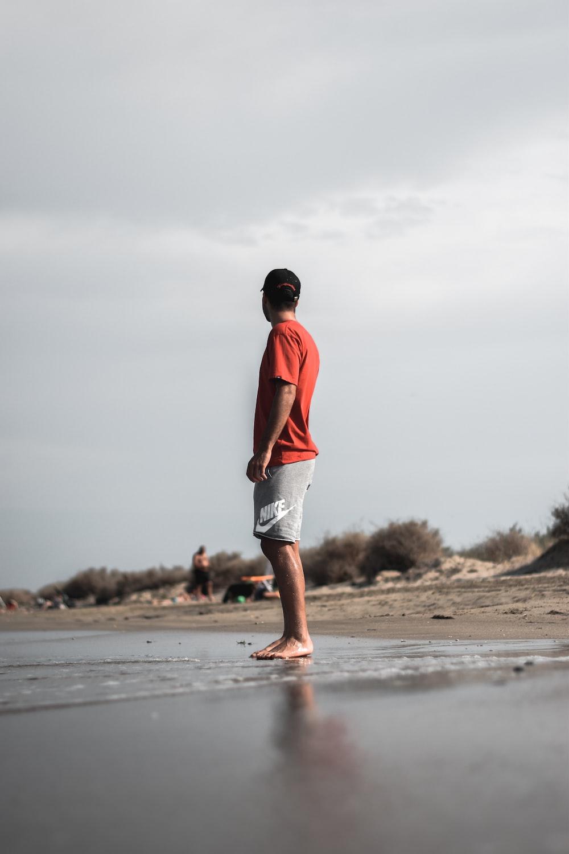 man standing on shore
