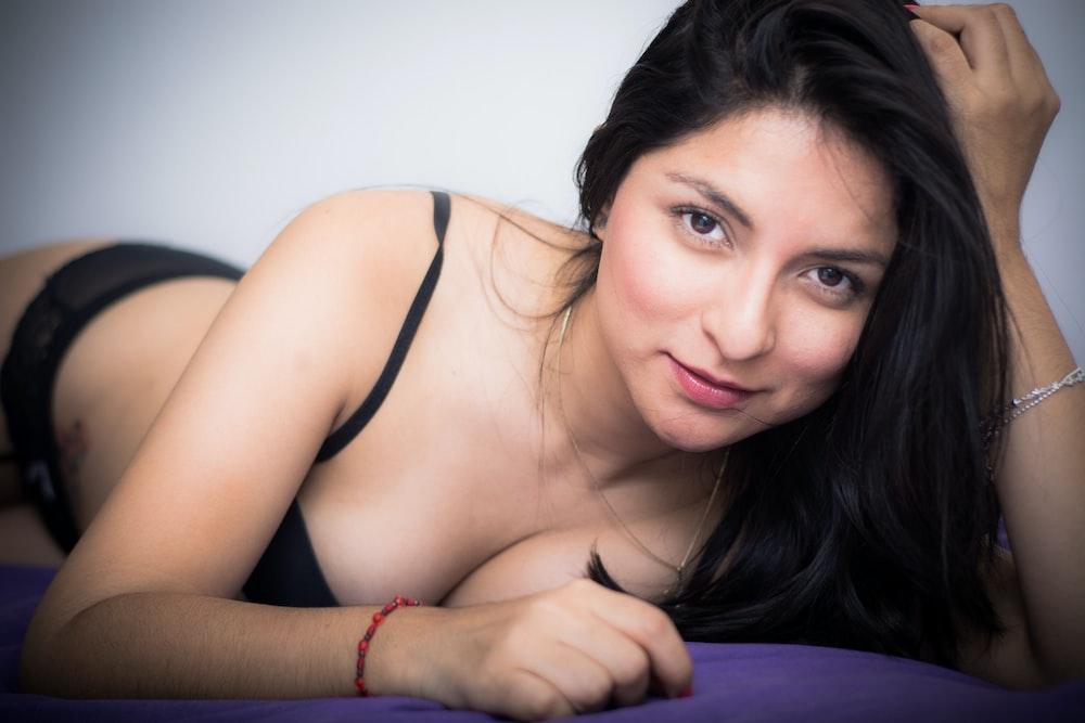 woman wearing black bra photo