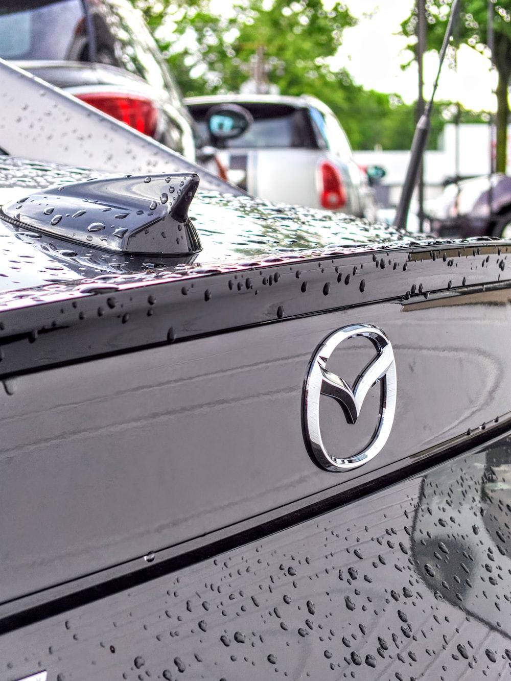 silver Mazda emblem
