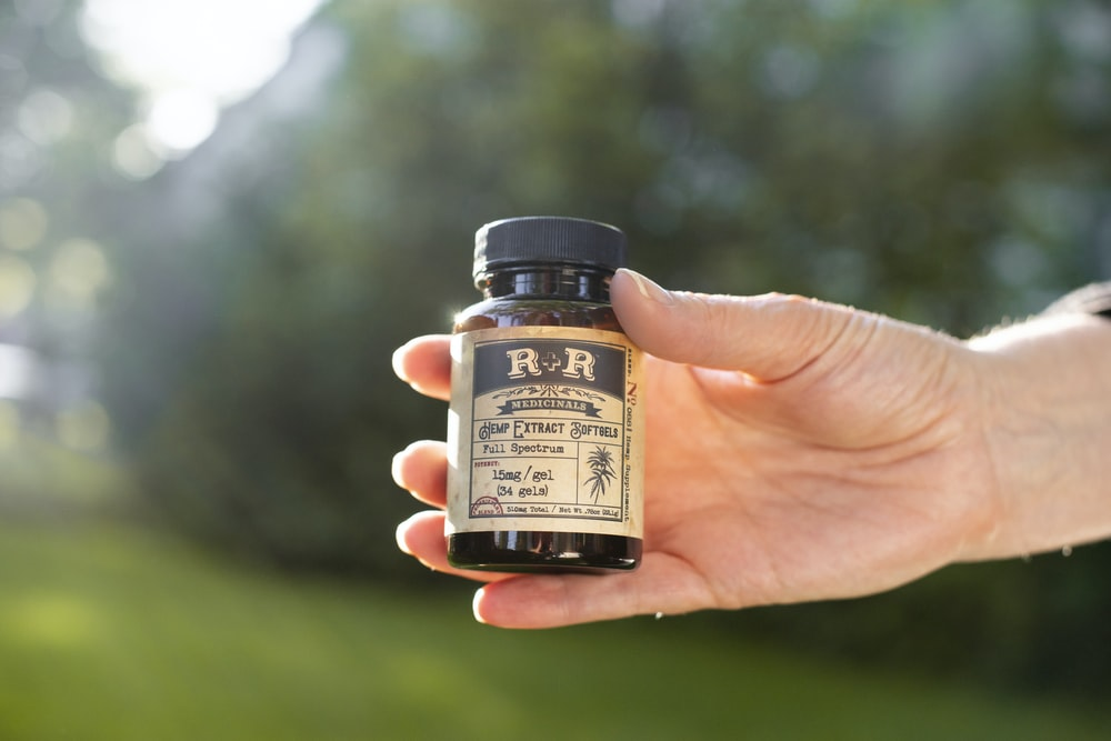 person holding R&R bottle