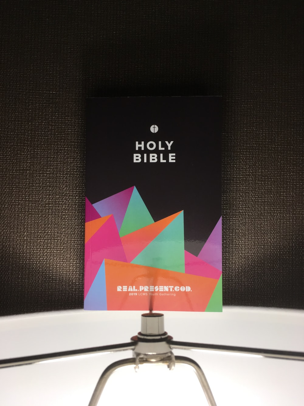 Holy Bible book on black textile