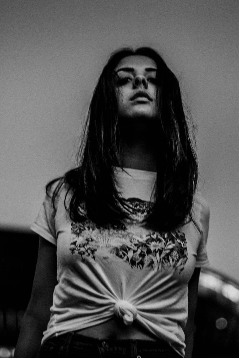 grayscale photo of woman in crew-neck t-shirt