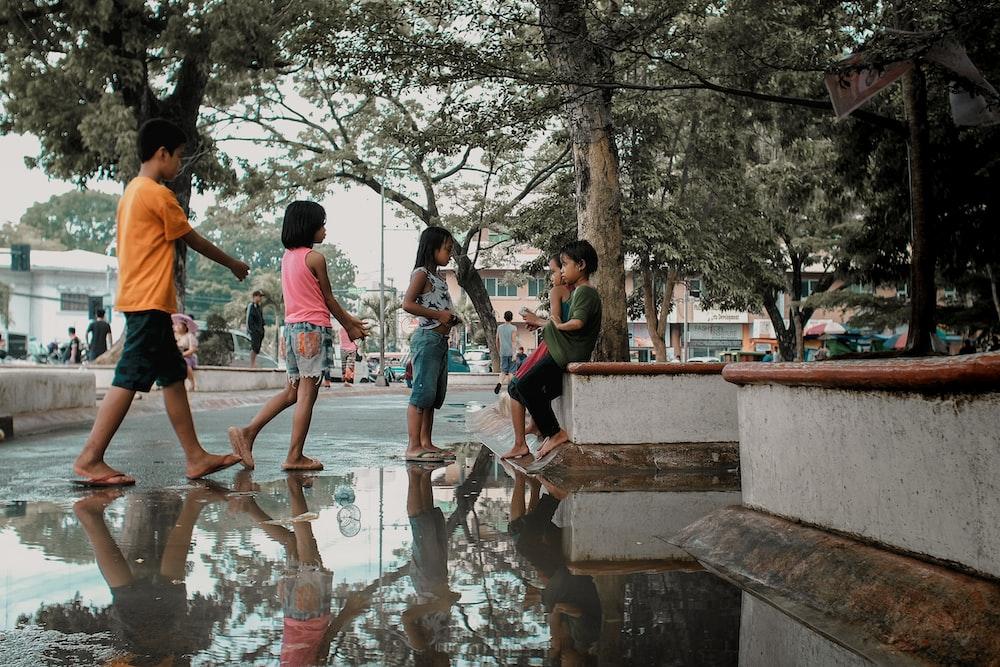children under green leafed trees