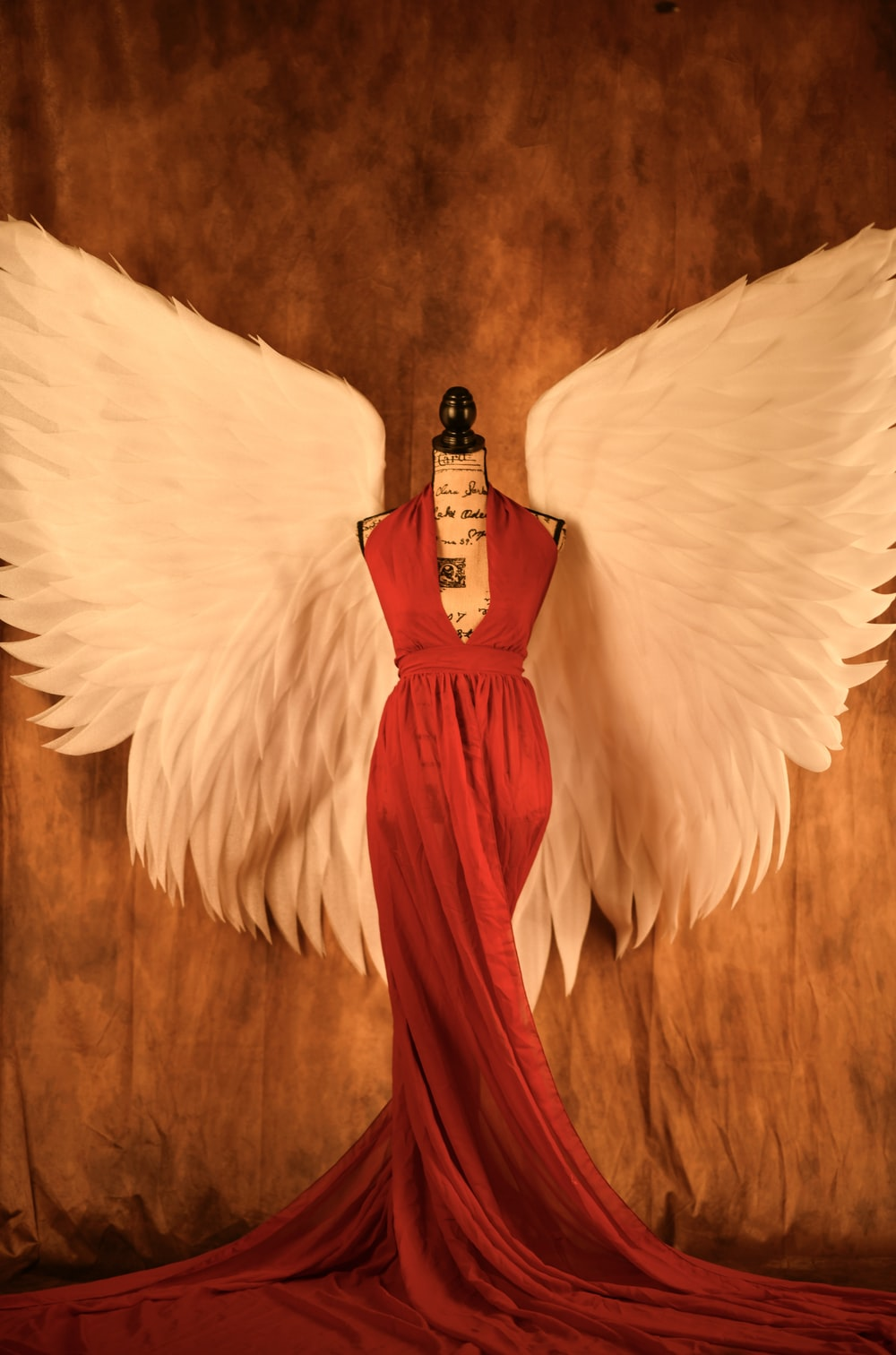 red halterneck long dress and white wings