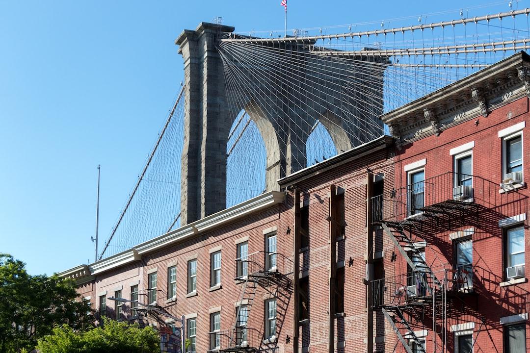 Brooklyn bridge across some historical brick facades in Brooklyn
