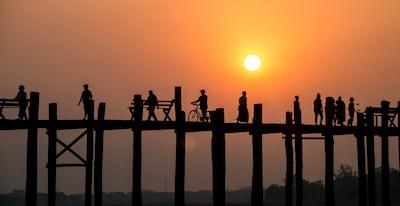silhouette of people on bridge myanmar teams background