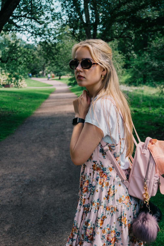 woman walking near trees