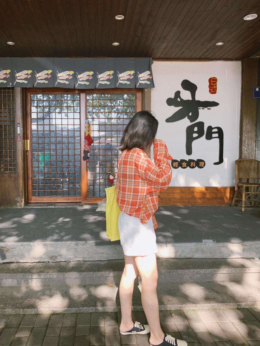 woman standing in front of slide doors