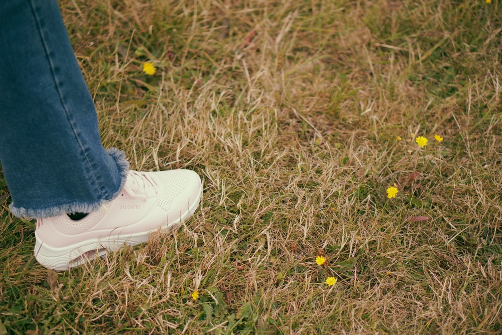 person standing on grass