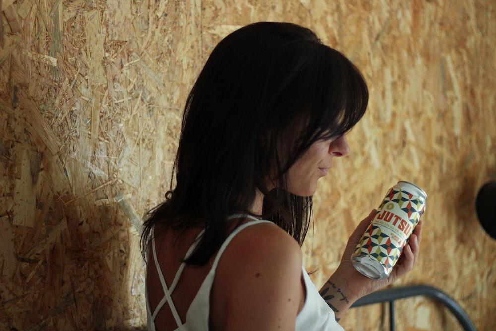 woman holding bottle