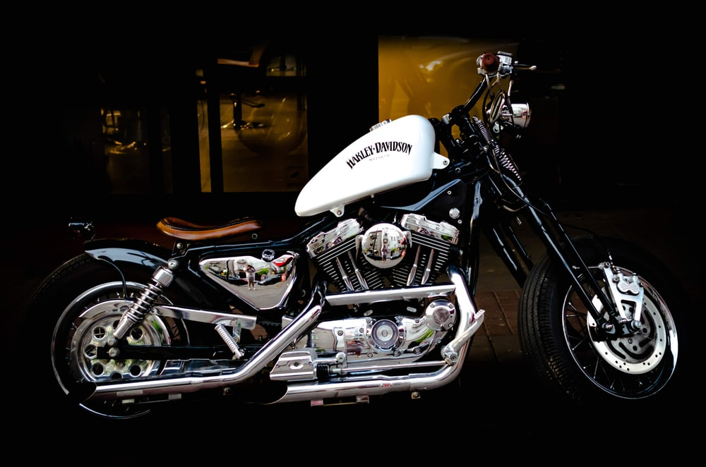 parked black and white motorcycle