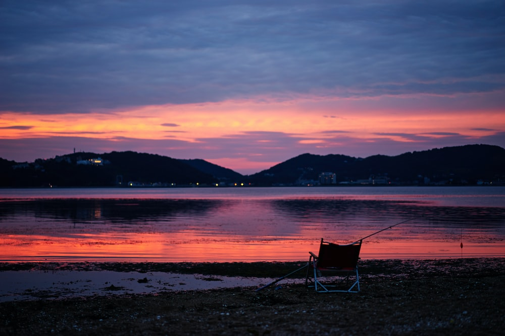 lounge chair at the shore during sunset