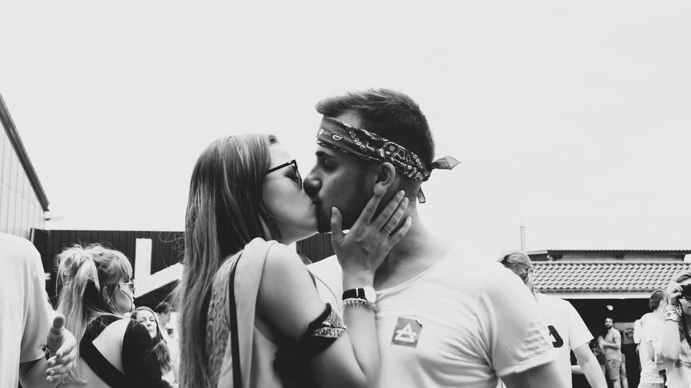 grayscale photography of couple kissing