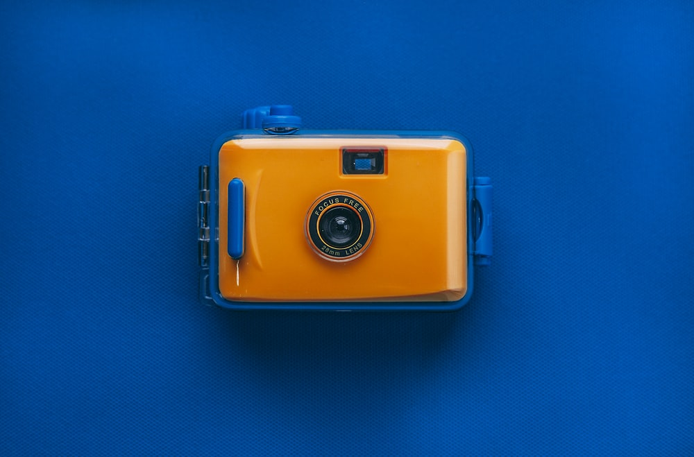 orange and black digital camera