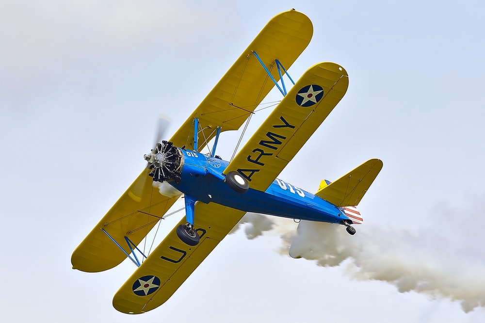 blue and yellow plane