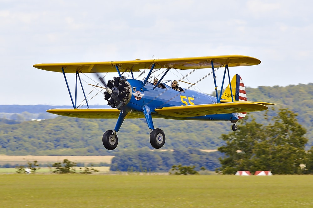 yellow and blue biplane
