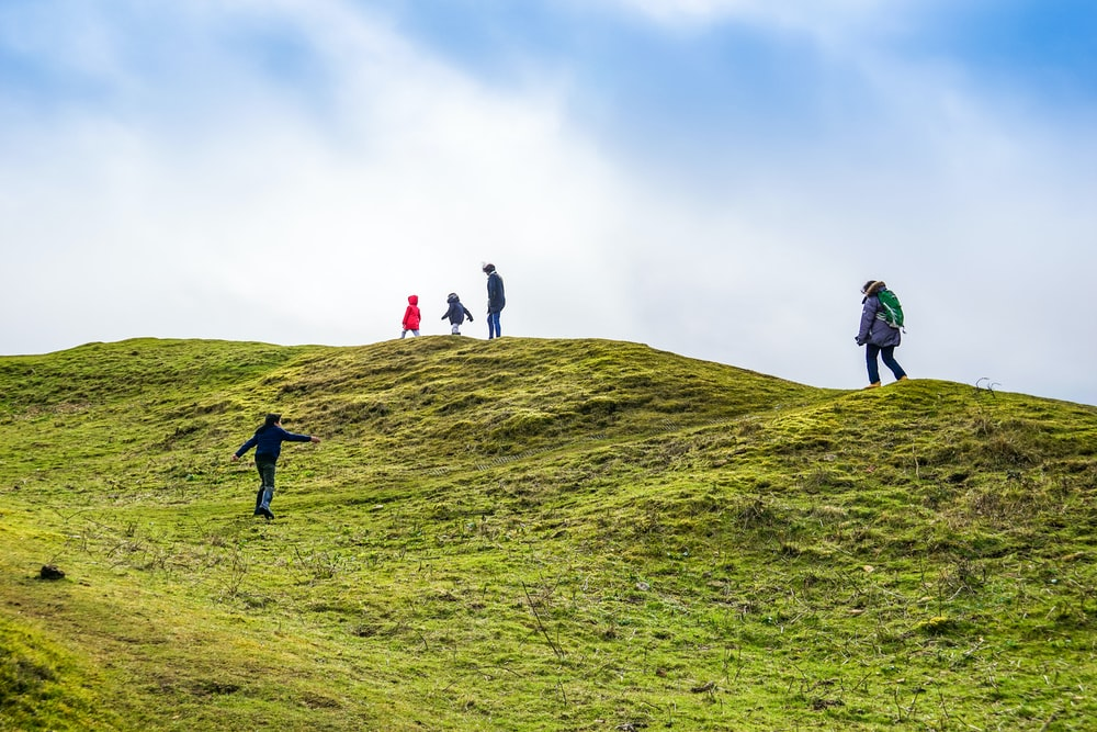 several people on mountain top